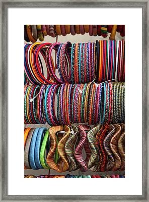 Bracelets, Pushkar, Rajasthan, India Framed Print by Inger Hogstrom