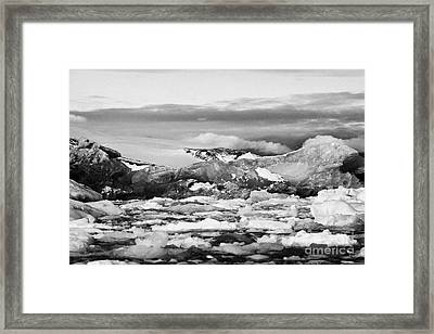 brash sea pack ice forming together with dirty blue iceberg as winter approaches cierva cove Antarct Framed Print by Joe Fox