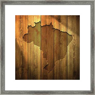 Brazil Map On Lit Wooden Background Framed Print by Bgblue