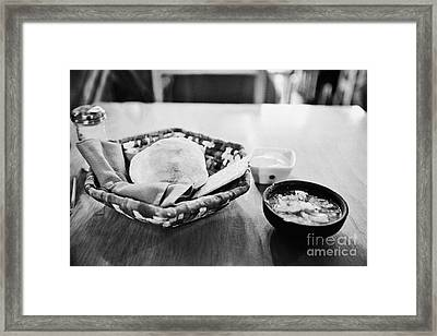 breads and salsa inside la luna restaurant Punta Arenas Chile Framed Print by Joe Fox