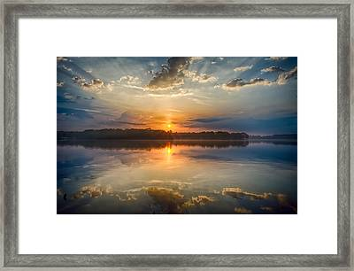 Breaking Through The Clouds Framed Print by Dan Holland