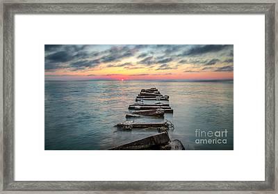 Breakwater Sunrise Framed Print by Andrew Slater