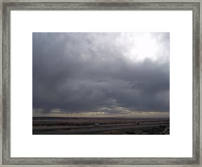 Brewing Storm Framed Print by Angela Stout