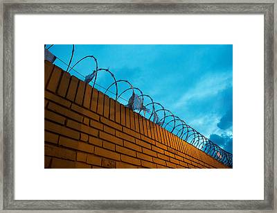 Brick Fence With Barbed Wire Framed Print