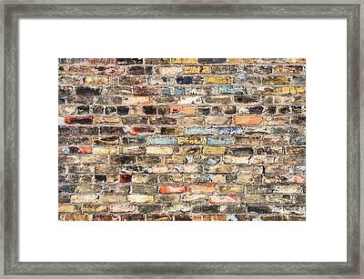 Brick Wall With History Framed Print by Jim Hughes