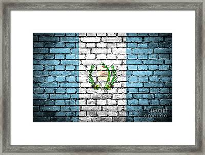 Brick Wall With Painted Flag Of Guatemala Framed Print by Aleksandar Mijatovic