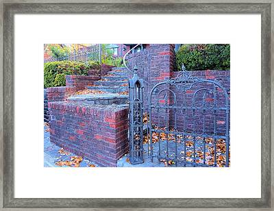 Framed Print featuring the photograph Brick Wall With Wrought Iron Gate by Janette Boyd