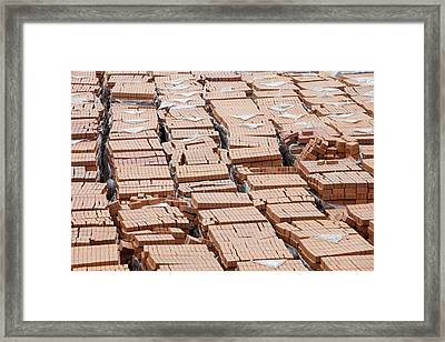 Bricks On A Building Site In Hong Kong Framed Print by Ashley Cooper