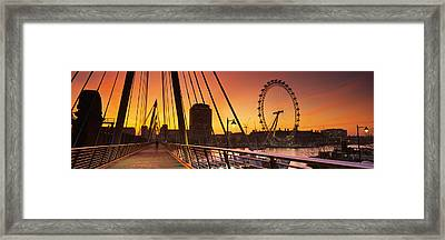 Bridge Across A River With A Ferris Framed Print