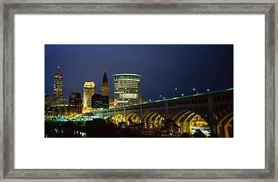 Bridge In A City Lit Up At Night Framed Print