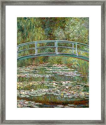 Bridge Over A Pond Of Water Lilies Framed Print by Claude Monet