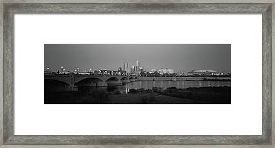Bridge Over A River With Skyscrapers Framed Print