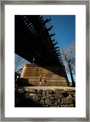Bridge Runners Framed Print by Geoffrey Baker