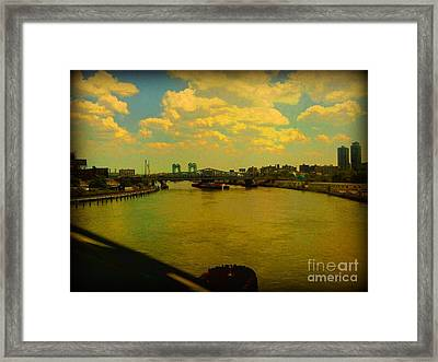 Bridge With Puffy Clouds Framed Print by Miriam Danar