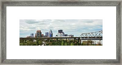 Bridge With Skyline In The Background Framed Print by Panoramic Images