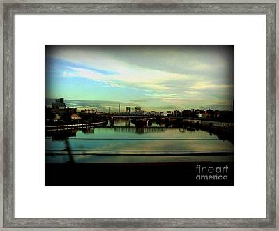 Bridge With White Clouds Framed Print by Miriam Danar