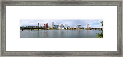 Bridges Across A River With City Framed Print