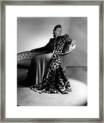 Bridget Bate Tichenor Sitting On A Chaise Lounge Framed Print by Horst P. Horst