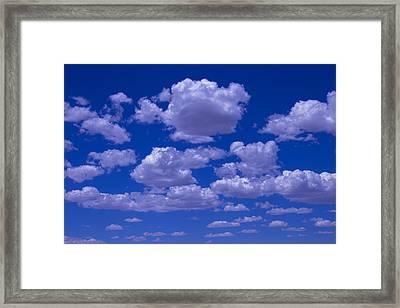 Bright Clouds Framed Print