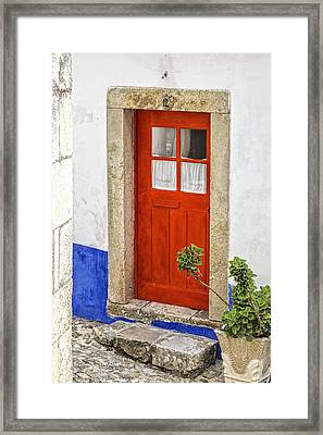 Bright Red Wood Door Of Portugal Framed Print by David Letts