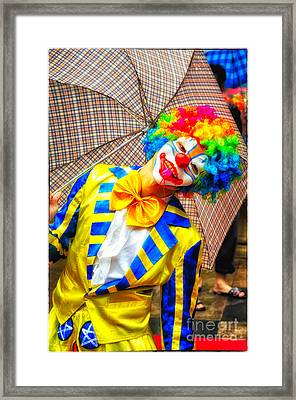 Brightly Dressed Clown With Umbrella Framed Print