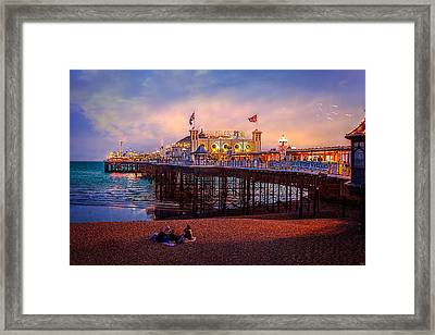 Brighton's Palace Pier At Dusk Framed Print by Chris Lord