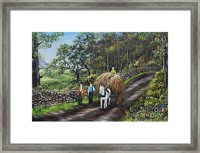 Bringing Home The Hay Framed Print by Avril Brand