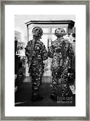 British Army Armed Soldiers In Riot Gear Watch Over House And Garden On Crumlin Road At Ardoyne Shop Framed Print by Joe Fox