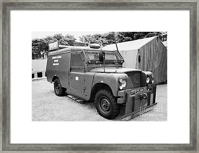 British Army Armoured Land Rover At Grey Point Fort Helens Bay County Down Northern Ireland Framed Print by Joe Fox