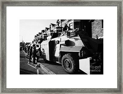 British Army Armoured Saxon Personnel Carrier Vehicle On Crumlin Road At Ardoyne Shops Belfast 12th  Framed Print by Joe Fox