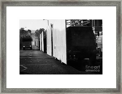 British Army Screen Bedford Trucks And Psni Water Canon On Crumlin Road At Ardoyne Shops Belfast 12t Framed Print by Joe Fox