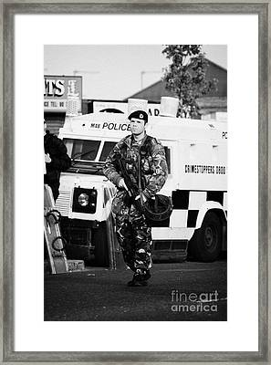 British Army Soldier At Psni Landrover On Crumlin Road At Ardoyne Shops Belfast 12th July Framed Print by Joe Fox