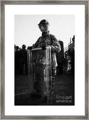 British Army Soldier In Riot Gear Stands Guard On Crumlin Road At Ardoyne Shops Belfast 12th July Framed Print by Joe Fox