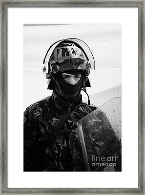 British Army Soldier In Riot Gear With Helmet And Shield On Crumlin Road At Ardoyne Shops Belfast 12 Framed Print by Joe Fox