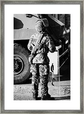 British Army Soldier In Riot Gear With Sa80 In Front Of Saxon Vehicle On Crumlin Road At Ardoyne Sho Framed Print by Joe Fox