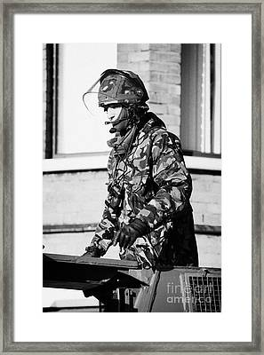 British Army Soldier In Turret Of Saxon Vehicle In Front Of Houses On Crumlin Road At Ardoyne Shops  Framed Print by Joe Fox
