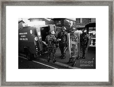 British Army Soldiers In Riot Gear Pack Up On Crumlin Road At Ardoyne Shops Belfast 12th July Framed Print by Joe Fox