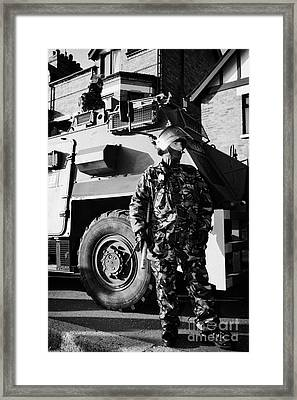 British Army Soldiers In Riot Gear With Saxon Armoured Personnel Carrier Vehicle On Crumlin Road At  Framed Print by Joe Fox