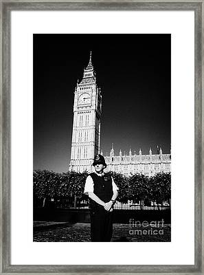 british metropolitan police office guarding the houses of parliament London England UK Framed Print