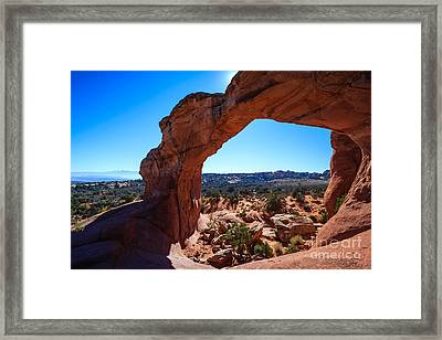 Framed Print featuring the photograph Broken Arch Under Blue Sky by Peta Thames