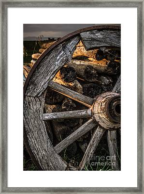Broken Cart Wheel With Missing Spoke And Logs On A Farm At Pacia Framed Print