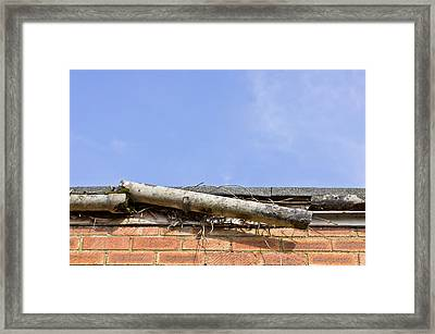 Broken Gutter Framed Print by Tom Gowanlock