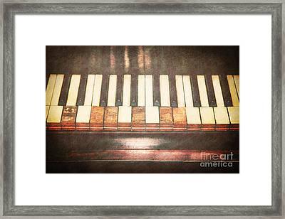 Broken Keys  Framed Print by Emily Kay