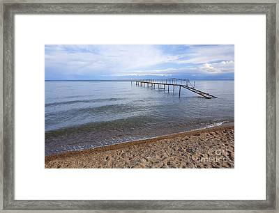 Broken Pier At Lake Issyk Kul In Kyrgyzstan Framed Print by Robert Preston