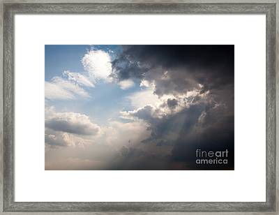 Broken Rain Clouds With Blue Sky And Sun Streaming Through Cloud Framed Print