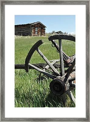 Broken Wagon Wheel And Log Building In Montana's Nevada City Framed Print