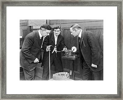 Brokers Checking Ticker Tape Framed Print by Underwood Archives