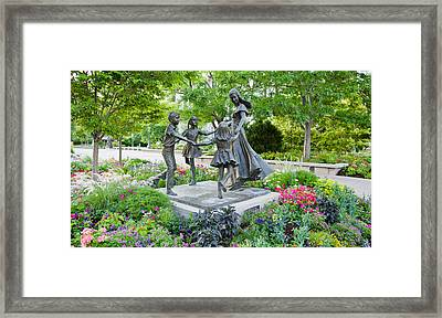 Bronze Statue Of Mother And Children Framed Print by Panoramic Images