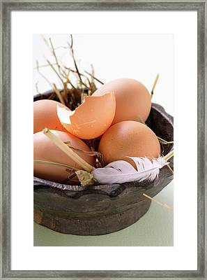 Brown Eggs, Eggshell And Feather In Wooden Bowl With Straw Framed Print