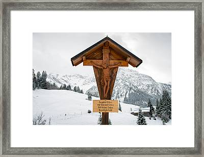 Brown Wayside Crucifix In The Mountains In Winter With Snow Framed Print